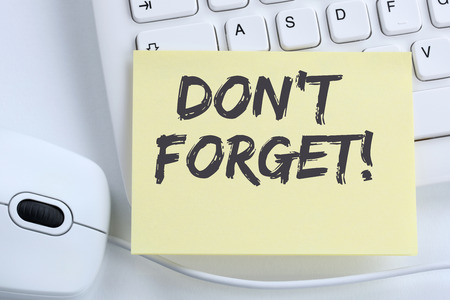 reminding: Dont forget date meeting remind reminder notepaper business concept office computer keyboard
