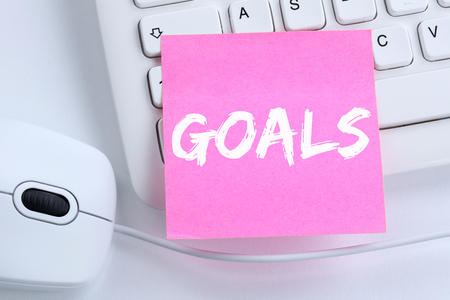 aspirational: Goal goals to success aspirations and growth business concept office computer keyboard Stock Photo