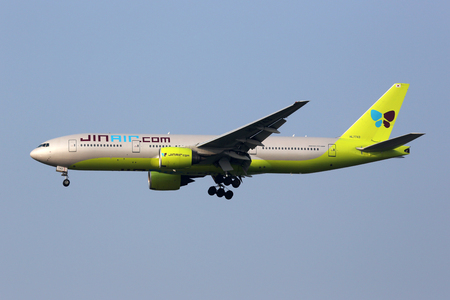 Incheon, South Korea - May 24, 2016: A Jin Air Boeing 777-200 airplane with the registration HL7743 approaching Seoul Incheon International Airport (ICN) in South Korea. Jin Air is an airline from South Korea with its headquarters in Incheon.