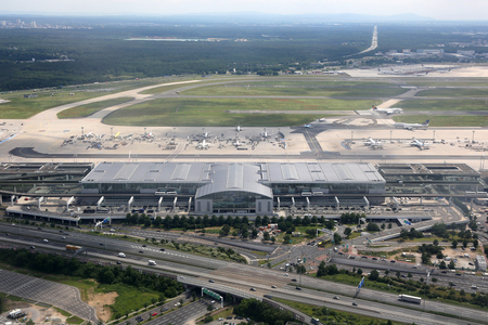 aerial photograph: Frankfurt, Germany - June 8, 2016: Terminal 2 of Frankfurt International Airport (FRA) in Germany. Frankfurt International Airport is the busiest airport in Germany and one of the busiest in Europe.