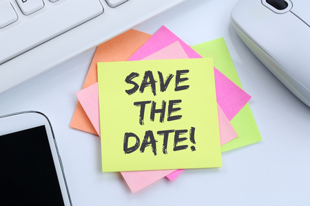 Save the date invitation message information desk computer keyboard Foto de archivo