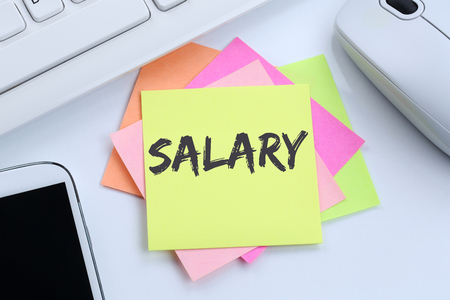 increase business: Salary increase negotiation wages money finance business concept desk computer keyboard