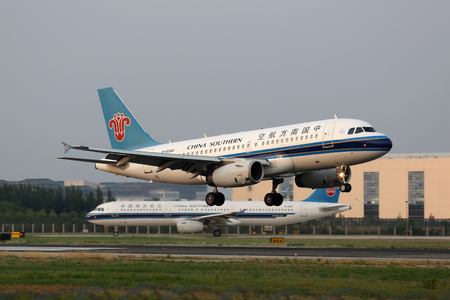 approaches: Beijing, China - May 19, 2016: A China Southern Airbus A319 with the registration B-6040 approaches Beijing Airport (PEK) in China. China Southern is the largest airline in Asia.