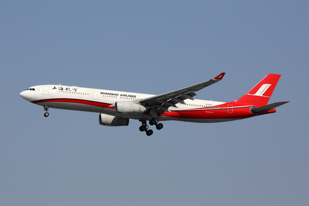 Shanghai, China - May 16, 2016: A Shanghai Airlines Airbus A330-300 with the registration B-6127 landing at Shanghai Hongqiao Airport (SHA) in China. Shanghai Airlines is a Chinese airline with its headquarters in Shanghai. Editöryel