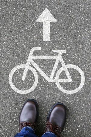 bike lane: Man people bike lane path way bicycle road traffic city transport