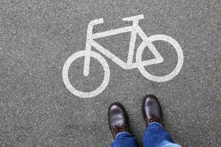 bike lane: Man people bike lane path way bicycle traffic city transport