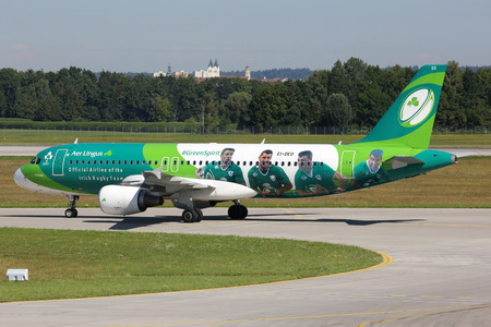 livery: Munich, Germany - August 8, 2016: An Aer Lingus Airbus A320 with the registration EI-DEO and the special livery Green Spirit taxis at Munich Airport (MUC) in Germany. Aer Lingus is the flag carrier airline of Ireland.
