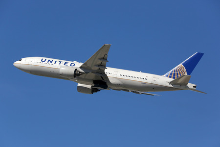 b: Los Angeles, USA - February 22, 2016: A United Airlines Boeing 777-200 with the registration N798UA takes off from Los Angeles International Airport (LAX) in the USA. United Airlines is an American airline headquartered in Chicago.