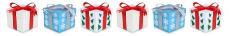 Christmas gifts gift box present in a row isolated on a white background Stock Photo