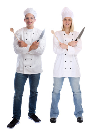 trainees: Cook apprentice trainee trainees cooks standing full body cooking with knife job young isolated on a white background Stock Photo
