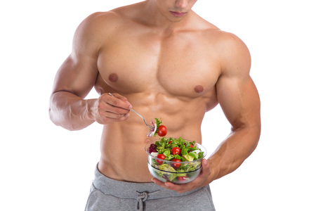 white men: Healthy eating food salad bodybuilding bodybuilder body builder building muscles muscular young man isolated on a white background
