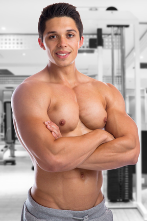 strong: Bodybuilder bodybuilding fitness gym muscles strong muscular young man studio