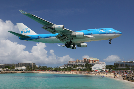 747 400: St. Martin, Netherlands Antilles - September 20, 2016: A KLM Royal Dutch Airlines Boeing 747-400 with the registration PH-BFN approaching St. Martin Airport (SXM) in the Netherlands Antilles. St. Martin is rated one of the most dangerous airports in the w