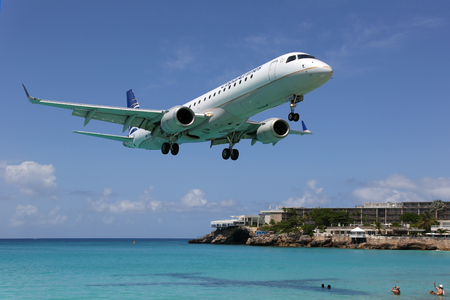Sint Maarten, Netherlands Antilles - September 20, 2016: A Copa Airlines Embraer ERJ190 with the registration HP-1540CMP approaching St. Martin Airport (SXM). St. Martin is rated one of the most dangerous airports in the world. Copa Airlines is the flag c