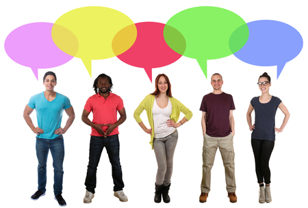 multi racial: Smiling multi ethnic group of young people talking speaking saying speech bubble copyspace Stock Photo
