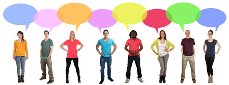 multi racial groups: Smiling multi ethnic large group of young people talking speaking saying speech bubble copyspace Stock Photo