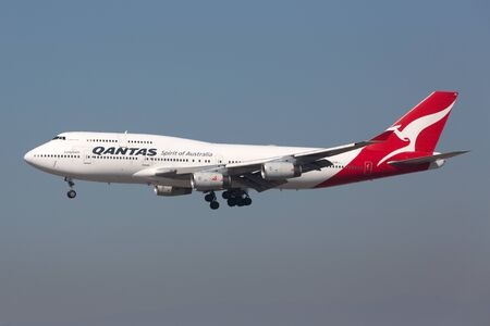 Los Angeles, USA - February 21, 2016: A Qantas Boeing 747-400 with the registration VH-OJS approaching Los Angeles International Airport (LAX) in the USA. Qantas is the flag carrier airline of Australia based in Sydney.