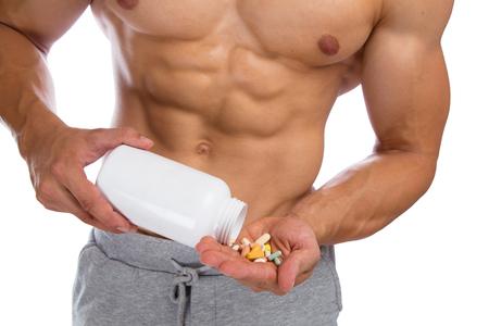 muscular body: Doping anabolic pills bodybuilder bodybuilding muscles body builder building strong muscular man Stock Photo