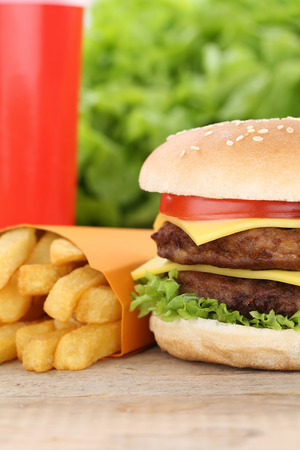 fast meal: Double cheeseburger hamburger and fries menu meal combo fast food cola drink