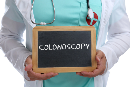 colonoscopy: Colonoscopy cancer prevention screening check-up disease ill illness young doctor with sign