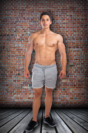 sixpack: Bodybuilder bodybuilding muscles standing whole body portrait muscular man sixpack Stock Photo