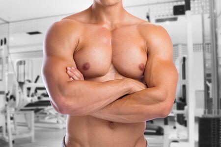 upper body: Bodybuilder bodybuilding chest muscles fitness gym upper body builder building strong muscular man studio