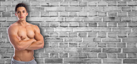 upper body: Bodybuilder bodybuilding muscles strong muscular copyspace upper body young man copy space