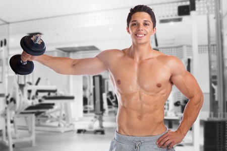 strong: Bodybuilder bodybuilding muscles gym shoulder shoulders training strong muscular man fitness studio Stock Photo