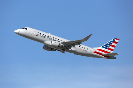 Los Angeles, USA - February 22, 2016: An American Eagle Embraer 175LR with the registration N217NN takes off from Los Angeles International Airport (LAX) in the USA. American Eagle operates regional feeder flights for American Airlines.
