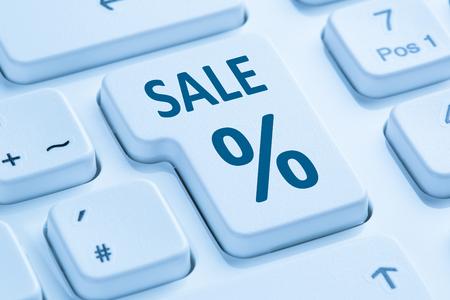 internet sale: Sale discount online shopping e-commerce internet shop concept symbol blue computer keyboard Stock Photo