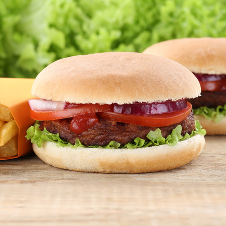 eating pastry: Hamburger and french fries tomatoes lettuce fast food