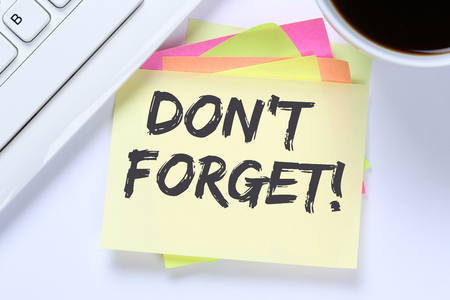 Don't forget date meeting remind reminder notepaper business desk computer keyboard