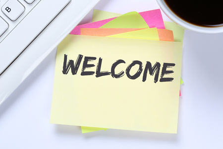 immigrants: Welcome new employee colleague refugees refugee immigrants computer desk keyboard Stock Photo