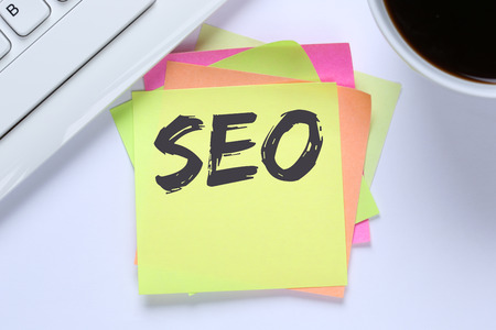 search searching: SEO Search Engine Optimization for websites internet business computer desk keyboard Stock Photo