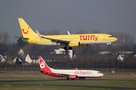 Dusseldorf, Germany - February 29, 2016: TUIfly and Air Berlin Boeing 737-800 airplanes at Dusseldorf Airport (DUS) in Germany. Air Berlin and TUIfly announced to found a new leisure airline together.