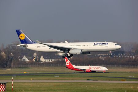 Dusseldorf, Germany - February 29, 2016: Lufthansa and Air Berlin airplanes at Dusseldorf Airport (DUS) in Germany. Lufthansa and Air Berlin announced a cooperation.