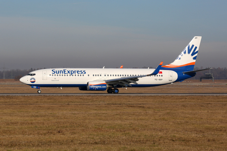 str: Stuttgart, Germany - December 22, 2016: A SunExpress Boeing 737-800 airplane with the registration TC-SEP at Stuttgart Airport (STR) in Germany. SunExpress is an airline from Turkey with its headquarters in Antalya. Editorial