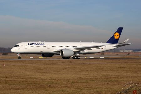 str: Stuttgart, Germany - December 22, 2016: A Lufthansa Airbus A350-900 with the registration D-AIXA at Stuttgart Airport (STR). Lufthansa is the largest airline in Germany.