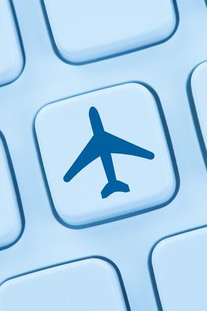 web shopping: Booking flight holidays vacation online shopping e-commerce internet travel shop web keyboard Stock Photo