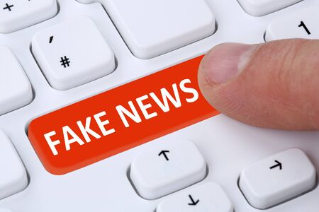 fake: Fake news truth lie media internet button online finger computer keyboard symbol Stock Photo