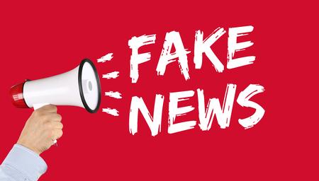 Fake news truth lie media internet online hand with megaphone
