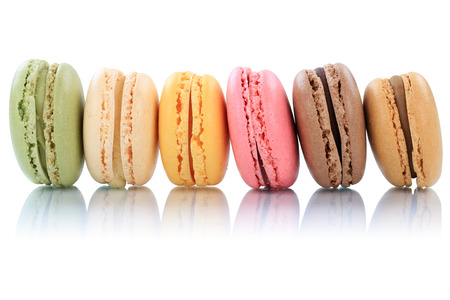 Macarons macaroons cookies dessert from France in a row isolated on a white background