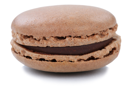 Chocolate macaron macaroon cookie dessert from France isolated on a white background