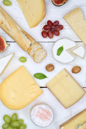 Cheese board platter plate Swiss bread Camembert portrait format top view above
