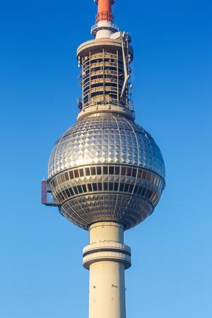 Berlin tv tower blue sky. Alexanderplatz Germany portrait format city travel Editorial