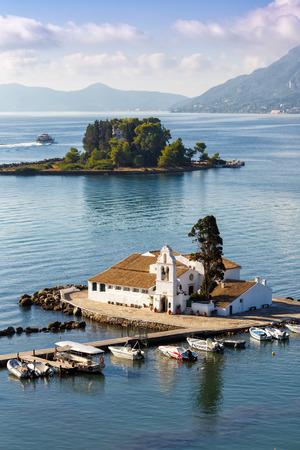 Corfu Greece Vlachernon Vlacherna church Kanoni island portrait format traveling sea boats boat
