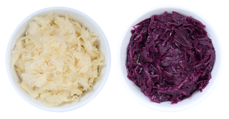 Sauerkraut coleslaw and red cabbage sliced from above bowl isolated on a white background