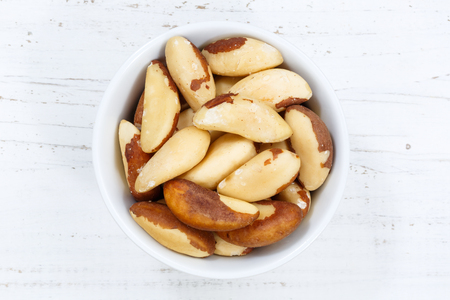 Brazil nut nuts from above bowl wooden board wood Stock fotó