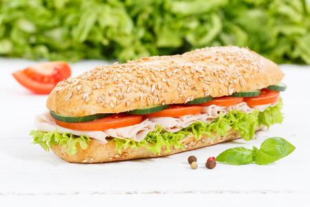 Sub sandwich whole grain grains baguette with ham on wooden board wood Archivio Fotografico