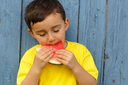 Child kid little boy eating watermelon summer copyspace copy space outdoor outdoors outside biting 版權商用圖片